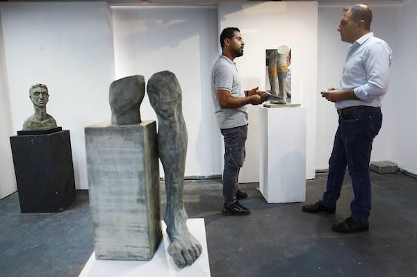 معرض فني يجسد معاناة مبتوري الأطراف في قطاع غزة 1
